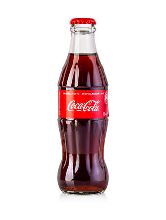Chisinau, Moldova - April 26, 2020: Classic bottle Of Coca-Cola isolated on white.With clipping path Editorial