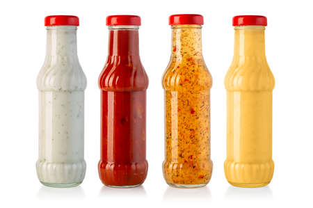 barbecue sauces in glass bottles isolated on white