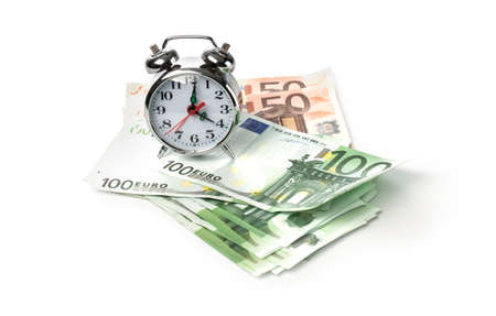 Alarm clock and money on white background with clipping path