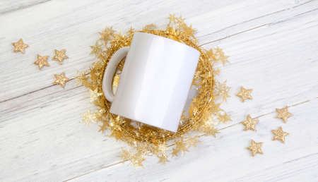white mug cup holiday mockup. Gold Stars wooden background. Christmas gifts