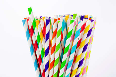 Paper straw of different colors on a white background with a copy space Foto de archivo