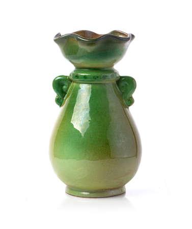 Green ceramic jug. Isolated on white background.