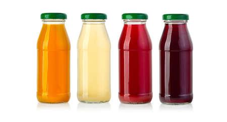 set of juice in glass bottles sisolated on white Foto de archivo