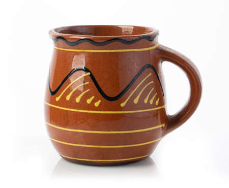 ceramic jug. Isolated on white background. Foto de archivo
