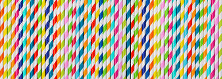 Paper straw of different colors background