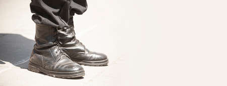 trampled military boots close-up with space for text Foto de archivo