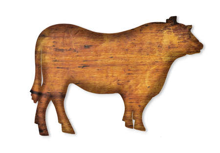 an old board in the shape of a cow isolated on white Foto de archivo