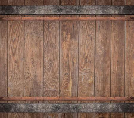 wooden barrel with metal rusty straps template background Foto de archivo