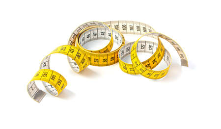 Measuring tape of tailor with indicators in form of centimeters. Yellow rolled measuring tape isolated on white background Foto de archivo