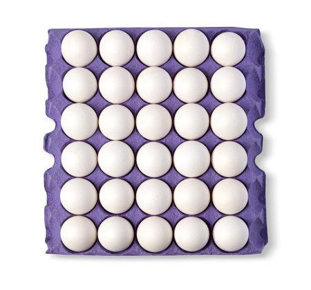 Egg in Cardboard egg tray on white background