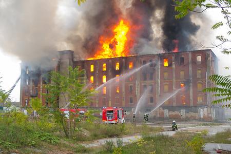 explosion engine: CELJE, SLOVENIA - OCTOBER 06, 2014: Firemen fight large-scale fire of historic industrial building Rakusev Mlin on October 6, 2014 in Celje Editorial