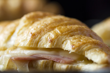 Close-up of newly baked butter croissant with ham and cheese sandwiches