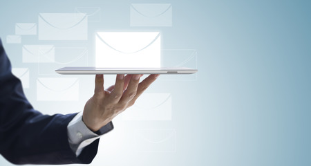 Butler holding a tablet serving most updated business information via email notification to customers for current business status with copy space. Isolated on white-blue gradient background. 版權商用圖片