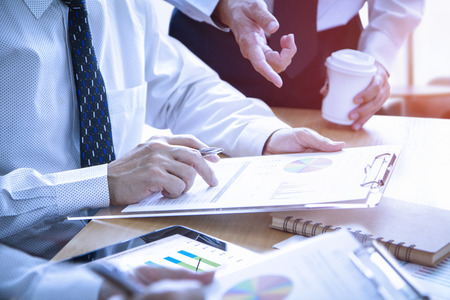 Businessmen in a meeting are deeply reviewing a financial reports for a return on investment or investment risk analysis. Reklamní fotografie