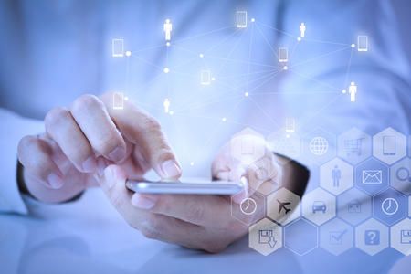 Man hands touching smartphone screen while using of mobile application for digital activities like online shopping, make a reservation or buying goods online.
