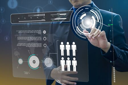 Business administrator in action of manpower or human resource planning or business organisation on a virtual dashboard. Stockfoto