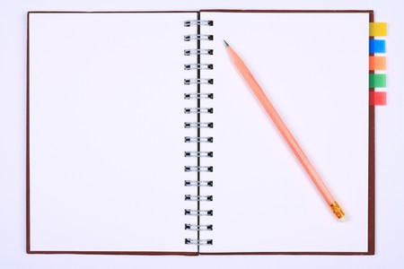 blank notebook with pencil, bookmark & white paper for take notes photo