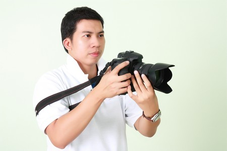 visually: Photographer in the Visually determined with Digital camera Stock Photo