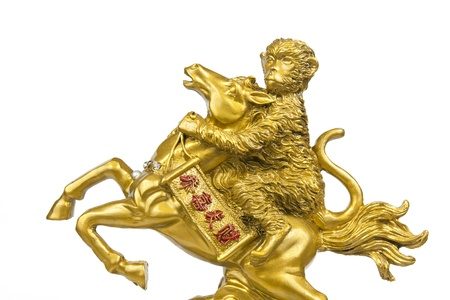 Golden statue monkey riding a horse, General amulet for Chinese belief on white background Stock Photo - 17188371