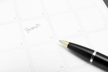 Bonus marked with pen on a calendar Stock Photo - 19787537