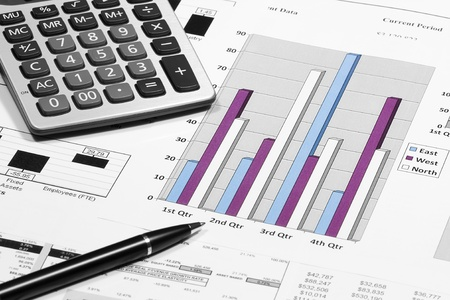business financial chart analysis with pen & calculator on paper work Stock Photo