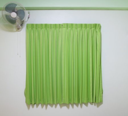 green curtain with fan in apartment photo