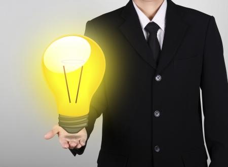 light bulb on hand businessman for great idea feeling Stock Photo