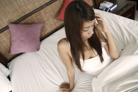 sexy pritty girl feel lonely on white bed photo
