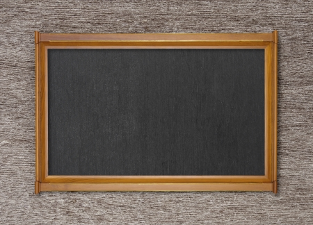 blank blackboard on ancient wood background photo