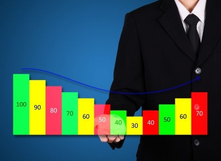 businessman present business statistic graph on blue photo