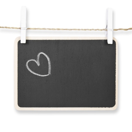 Hand drawing heart on blackboard, isolated included clipping path photo