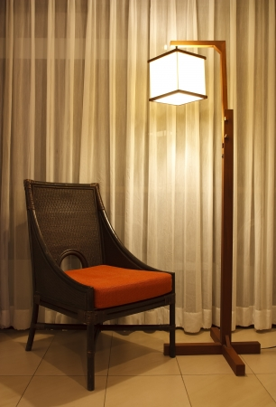 rattan chair with warm white lamp & curtain, warm feeling photo