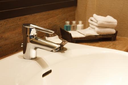 washbasin set in hotel on warm white Stock Photo