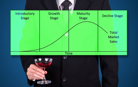 businessman holding wine glass show success business statistic graph on blue photo