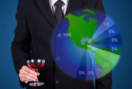 businessman holding wine glass show success market share on blue photo