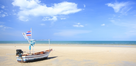 huahin: Tourist and fishing boat on the beach at Huahin in Thailand, clear sky (use Polarizing Filter)