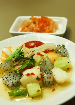 spicy fruits salad with  salmon mashed mix cavier at japanese restaurant photo