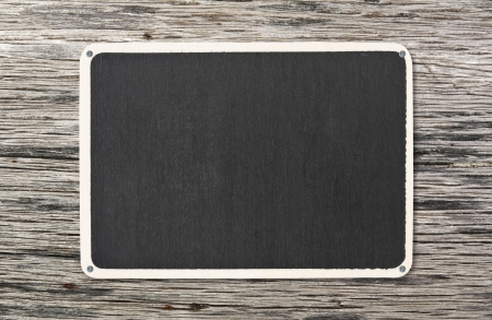 blank blackboard on old wooden plate background photo