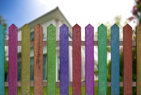 colorful fence with beautiful home background Stock Photo