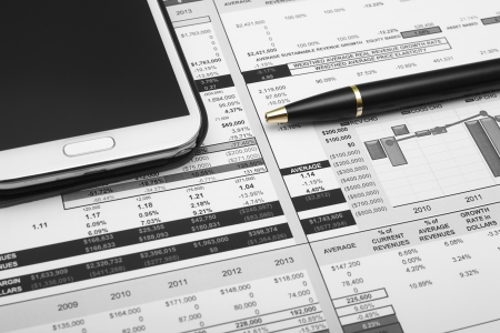 business analysis chart with pen & smartphone Stock Photo