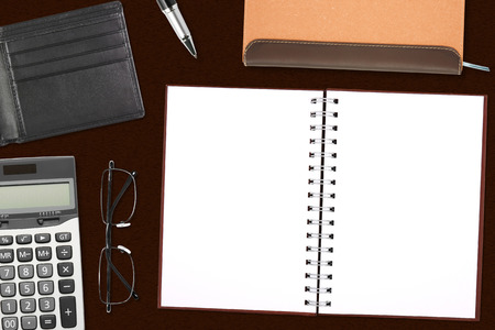 blank brown notebook & pocket card with stationery on the desk for your text or card