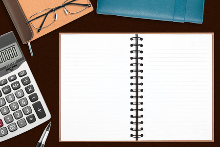 blank recycle notebook with stationery on the desk for your text