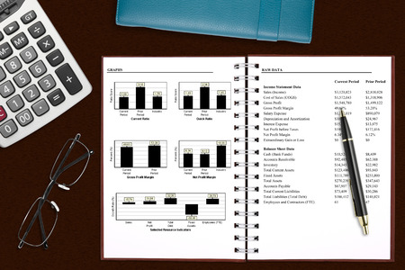 financial analysis book with stationery on the desk