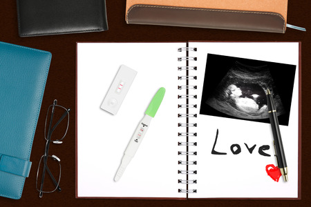 Notebook for baby with wallet & eyeglasses on the desk