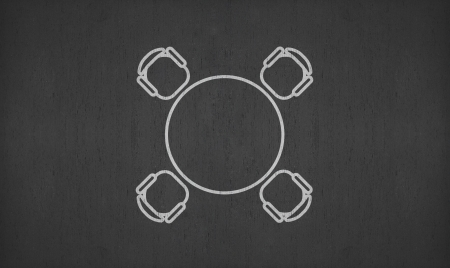 concurrent: blank circular meeting table on blackboard for your ideas Stock Photo