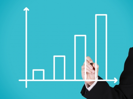 businessman writing on blank business progress graph, blue background photo