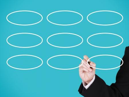 businessman writing on blank circle, blue background photo