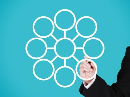 businessman writing on blank circular marketing network, blue background photo