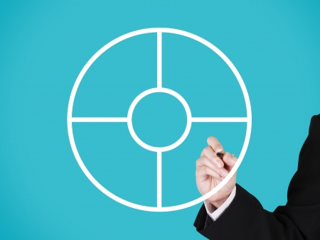 businessman writing on blank circular marketing partition, blue background photo