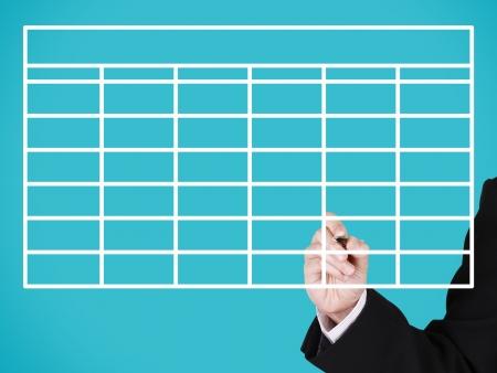 businessman writing on blank develop chart, blue background photo
